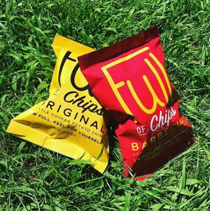 bags of chips in grass
